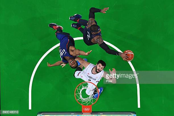 Carmelo Anthony of the United States handles the ball against Stefan Markovic of Serbia during the Men's Gold medal game on Day 16 of the Rio 2016...