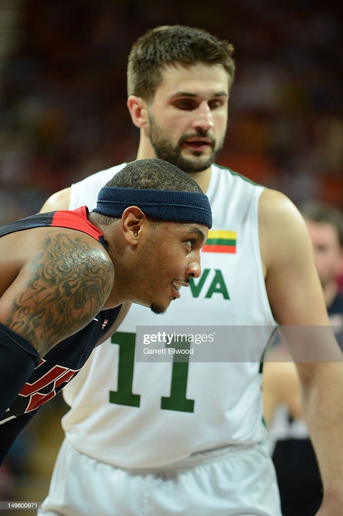 Carmelo Anthony #15 of the United States rests versus Linas Kleiza #11 of Lithuania during their Basketball Game on Day 8 of the London 2012 Olympic Games at the Olympic Park Basketball Arena on August 4, 2012 in London, England.