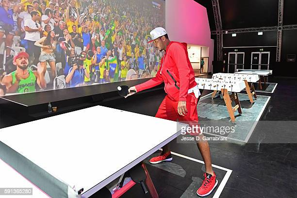 Carmelo Anthony of the USA Basketball Men's National Team plays ping pong while visiting the Team Nike House during the Rio 2016 Olympic Games on...