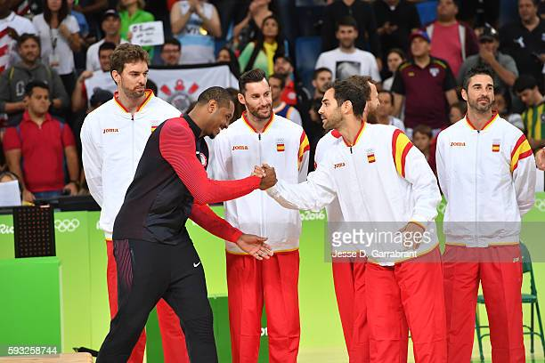 Carmelo Anthony of the USA Basketball Men's National Team shakes hands with Jose Calderon of Spain after winning the Gold Medal Game against Serbia...