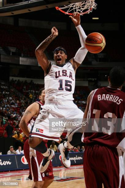 Carmelo Anthony of the USA Men's Senior National Team dunks against Manuel Barrios of Venezuela during the first round of the 2007 FIBA Americas...