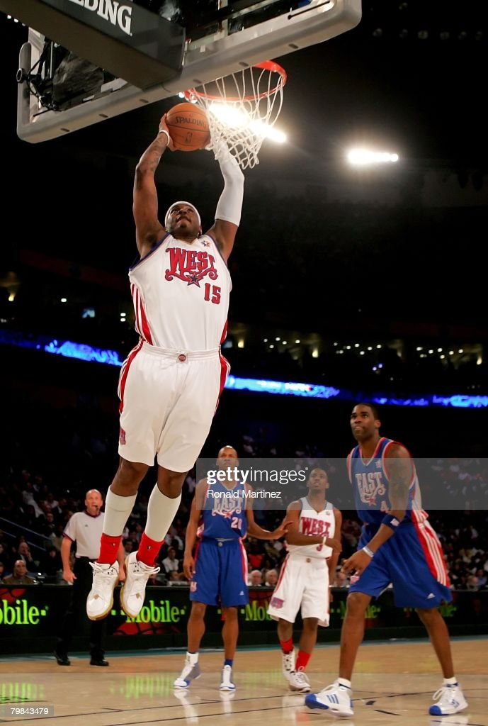 Carmelo Anthony #15 of the Western Conference goes up for a slam dunk over Antawn Jamison #4 and Ray Allen #20 of the Eastern Conference during the 57th NBA All-Star Game, part of 2008 NBA All-Star Weekend at the New Orleans Arena on February 17, 2008 in New Orleans, Louisiana. The East won 134-128.