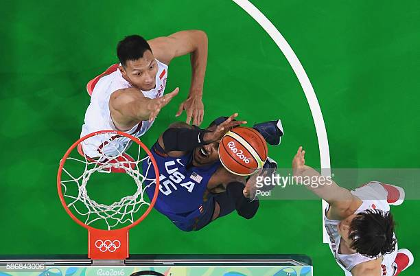 Carmelo Anthony of United States goes to the basket against Jianlian Yi of China in the Men's Preliminary Round Group A match on Day 1 of the Rio...