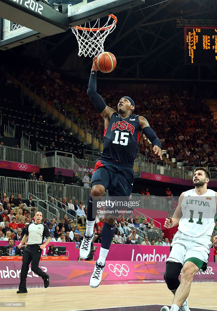 Carmelo Anthony #15 of United States goes up for a slam dunk against Lithuania during the Men's Basketball Preliminary Round match on Day 8 of the London 2012 Olympic Games at the Basketball Arena on August 4, 2012 in London, England.