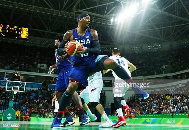 Carmelo Anthony of United States grabs a rebound against Serbia during the Men's Gold medal game on Day 16 of the Rio 2016 Olympic Games at Carioca...