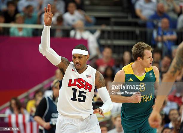 Carmelo Anthony of United States reacts after making a threepointer alongisde Brad Newley of Australia in the third quarter during the Men's...