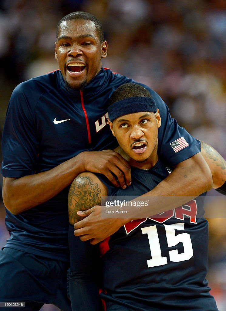 Carmelo Anthony #15 of United States reacts in the second half after making a three-pointer with teammate Kevin Durant #5 while taking on Argentina during the Men's Basketball semifinal match on Day 14 of the London 2012 Olympic Games at the North Greenwich Arena on August 10, 2012 in London, England.