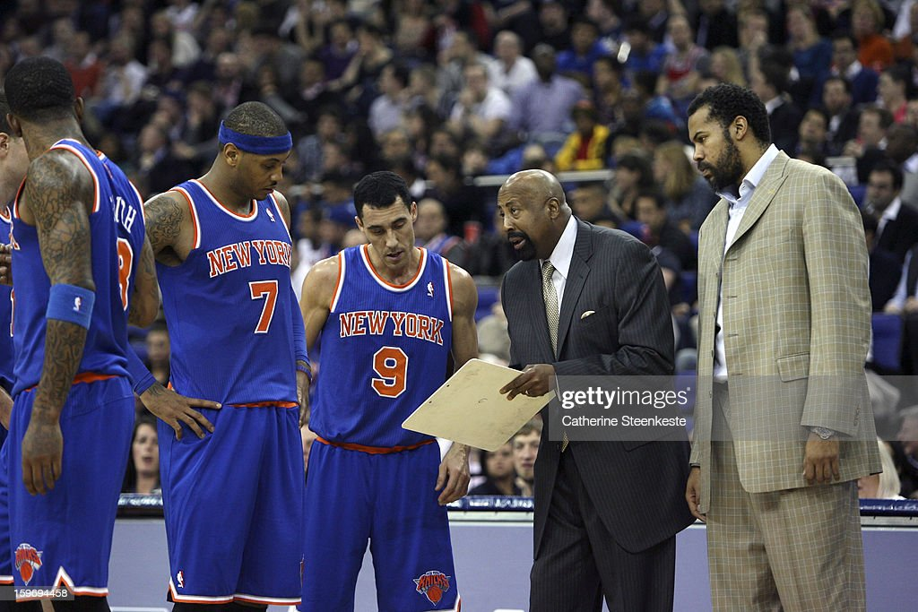 Carmelo Anthony #7, Pablo Prigioni #9 and Rasheed Wallace of the New York Knicks are listening to Mike Woodson Head Coach of the New York Knicks during a game against the Detroit Pistons at the O2 Arena on January 17, 2013 in London, England.