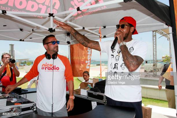 Carmelo Anthony participates with DJ Boogie of Nick Radio as part of Worldwide Day of Play at Bahia Urbana Bay Side Park on August 12 2017 in San...