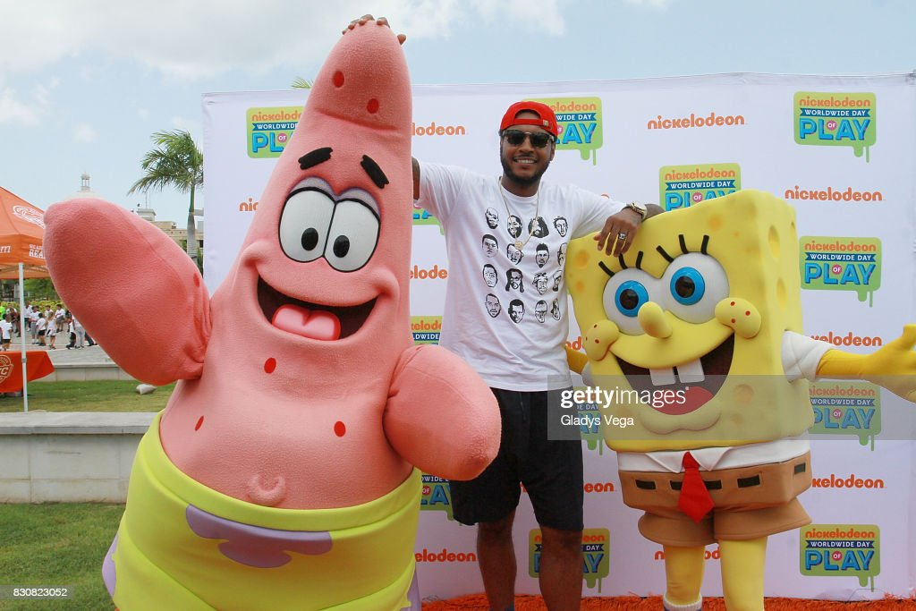 Carmelo Anthony poses with Nickelodeon Characters as part of Worldwide Day of Play at Bahia Urbana Bay Side Park on August 12, 2017 in San Juan, Puerto Rico.