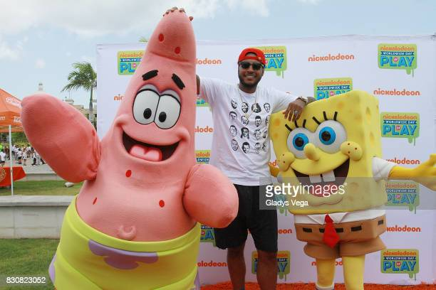 Carmelo Anthony poses with Nickelodeon Characters as part of Worldwide Day of Play at Bahia Urbana Bay Side Park on August 12 2017 in San Juan Puerto...