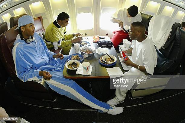 Carmelo Anthony Rodney White Earl Boykins and Andre Miller eat while the Denver Nuggets fly to Orlando for a game against the Orlando Magic on...