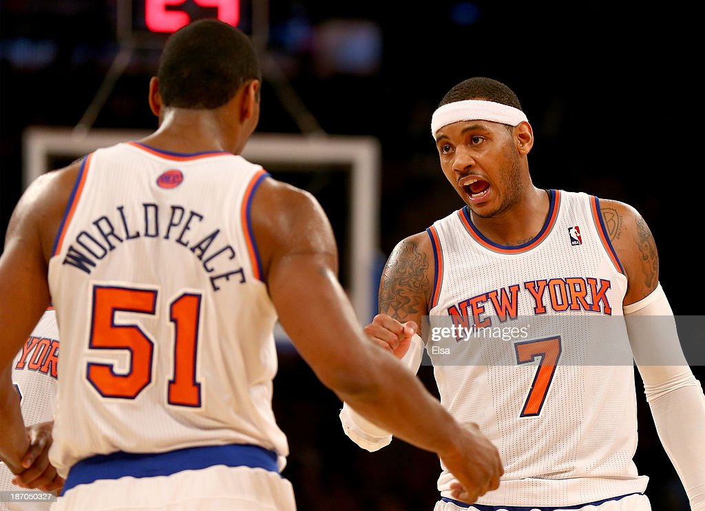 Carmelo Anthony #7 talks with Metta World Peace #51 of the New York Knicks in the second half against the Charlotte Bobcats at Madison Square Garden on November 5, 2013 in New York City.The Charlotte Bobcats defeated the New York Knicks 102-97.