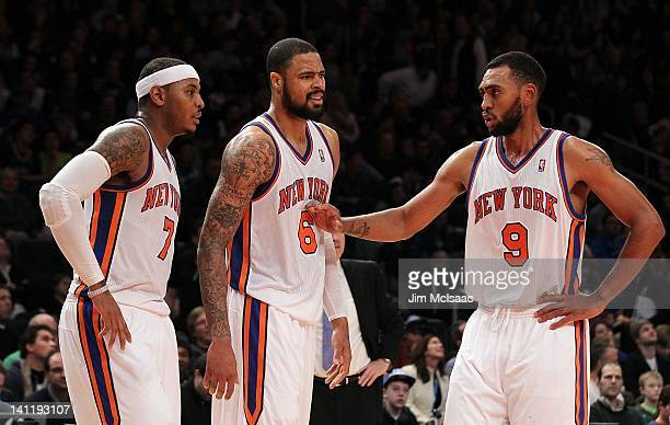 Carmelo Anthony Tyson Chandler and Jared Jeffries of the New York Knicks in action against the Orlando Magic on January 16 2012 at Madison Square...