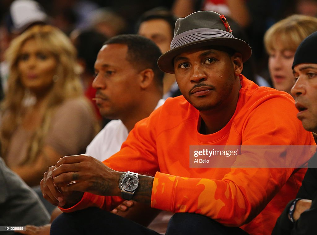 <a gi-track='captionPersonalityLinkClicked' href=/galleries/search?phrase=Carmelo+Anthony&family=editorial&specificpeople=201494 ng-click='$event.stopPropagation()'>Carmelo Anthony</a> watches the USA against Puerto Rico game at Madison Square Garden on August 22, 2014 in New York City.