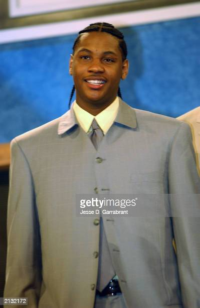 Carmelo Anthony who was selected by the Denver Nuggets looks on during the 2003 NBA Draft at the Paramount Theatre at Madison Square Garden on June...