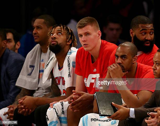 Carmelo AnthonyDerrick WilliamsKristaps Porzingis and Arron Afflalo of the New York Knicks look on from the bench in the final minutes of the game...
