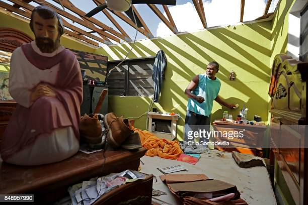 Carmelo Mota searches for tools in his destroyed bedroom more than a week after Hurricane Irma made landfall September 18 2017 in Charlotte Amalie St...