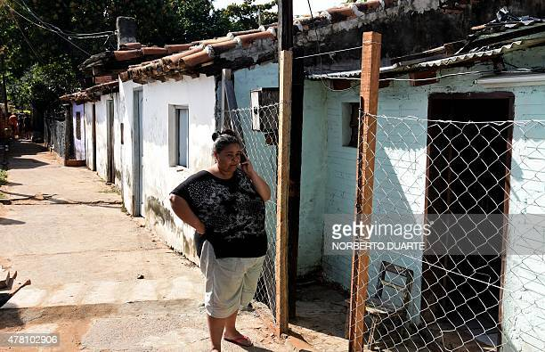 Carmen a Paraguayan whose husband has cancer and hopes for a miracle when Pope Francis visits her next month stands outside her house in Banado Norte...