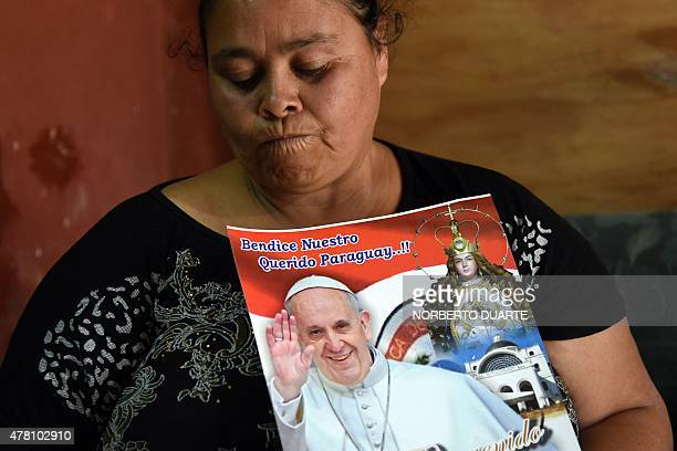 Carmen a Paraguayan whose husband has cancer and hopes for a miracle when Pope Francis visits her next month poses during an interview with AFP at...