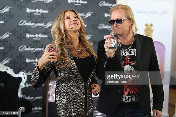 Carmen and Robert Geiss attend the launch of a new fragrance 'Roberto Geissini' on March 10 2016 in Cologne Germany