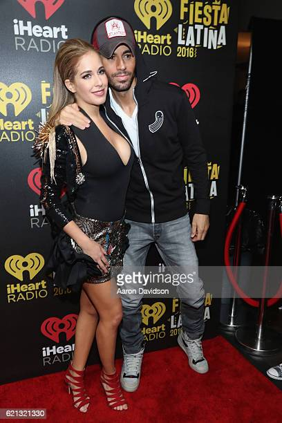 Carmen Aub and Enrique Iglesias attend iHeartRadio Fiesta Latina American Airlines Arena on November 5 2016 in Miami Florida