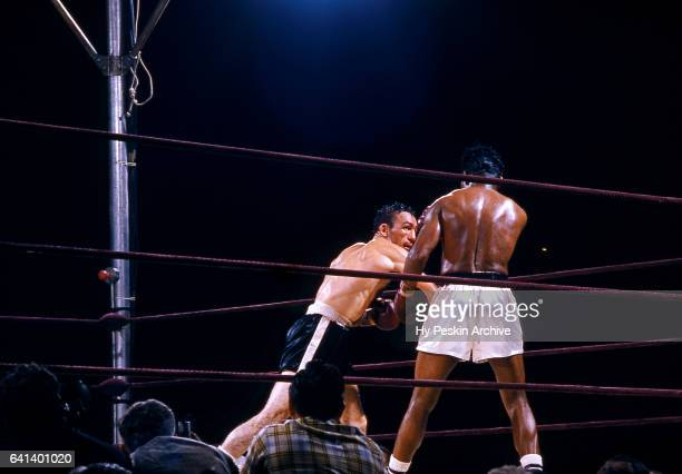 Carmen Basilio punches Sugar Ray Robinson during the World Middleweight Title Fight on September 23 1957 at Yankee Stadium in the Bronx New York