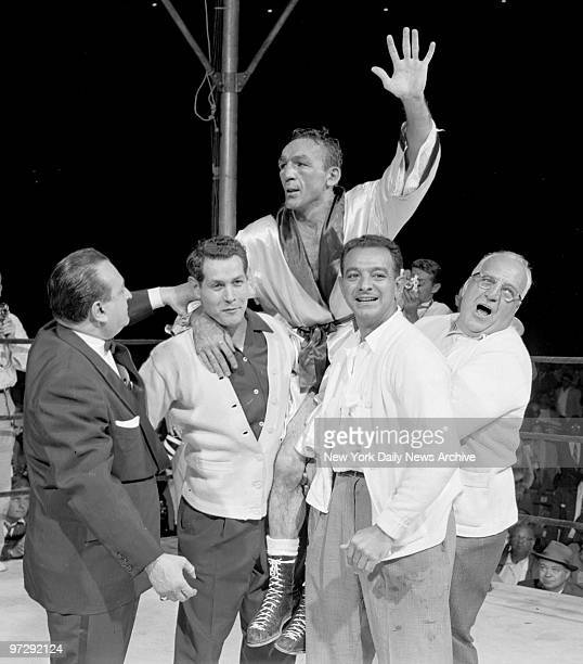 Carmen Basilio raises his hands in victory after winning a 15round split decision over Sugar Ray Robinson at Yankee Stadium