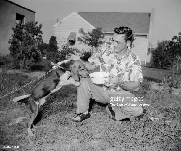 Carmen Basilio spends some quality time with his dog while training in Alexandria Bay New York 1957