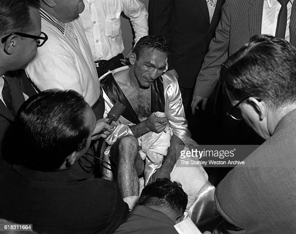 Carmen Basilio talking to the press after winning the middleweight title from Sugar Ray Robinson in Yankee Stadium Bronx New York on September 23 1957