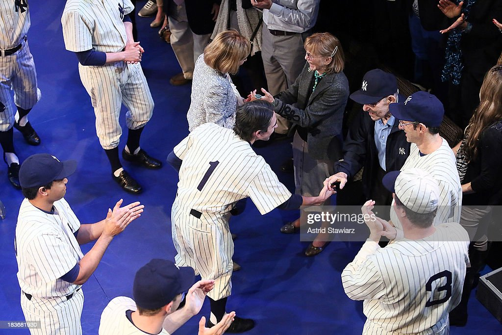 Carmen Berra and former New York Yankees player and manager Yogi Berra are greeted by the cast of 'Bronx Bombers' during its opening night curtain call at Primary Stages on October 8, 2013 in New York City.