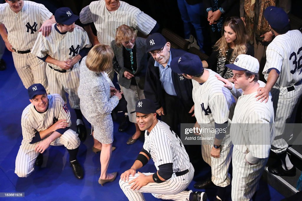 Carmen Berra and former New York Yankees player and manager <a gi-track='captionPersonalityLinkClicked' href=/galleries/search?phrase=Yogi+Berra&family=editorial&specificpeople=94270 ng-click='$event.stopPropagation()'>Yogi Berra</a> pose with the cast of 'Bronx Bombers' during its opening night curtain call at Primary Stages on October 8, 2013 in New York City.