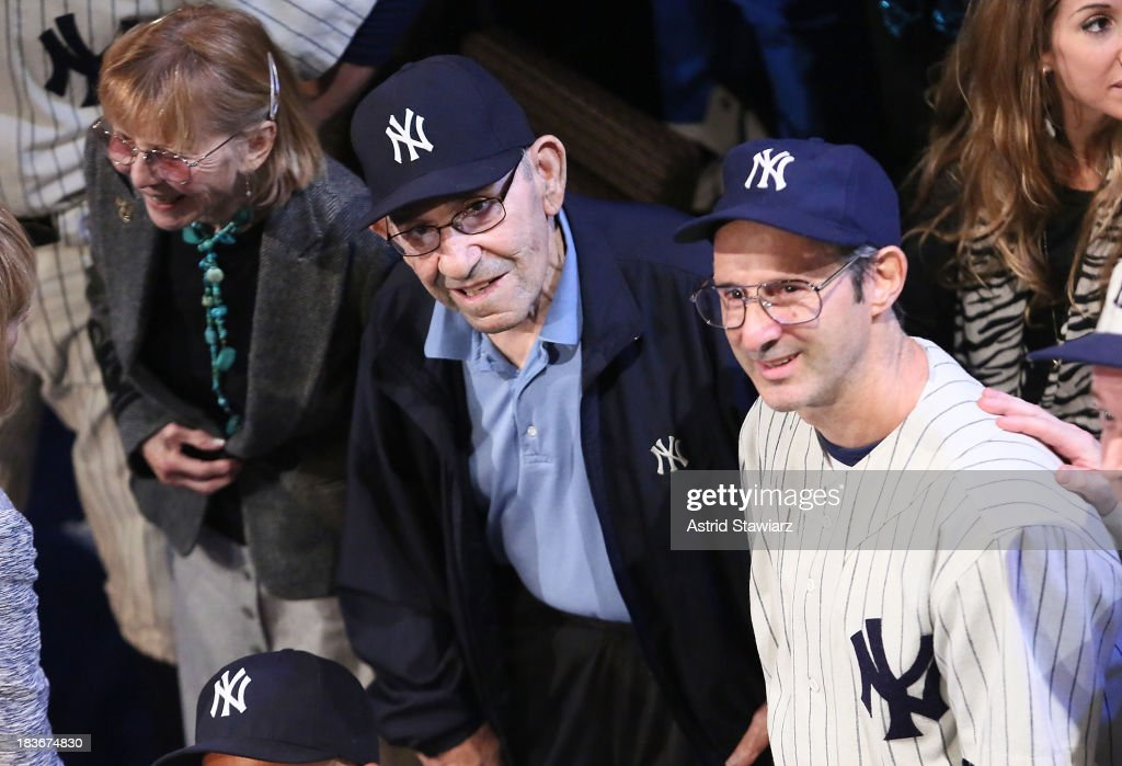 Carmen Berra, former New York Yankees player and manager <a gi-track='captionPersonalityLinkClicked' href=/galleries/search?phrase=Yogi+Berra&family=editorial&specificpeople=94270 ng-click='$event.stopPropagation()'>Yogi Berra</a> pose with actor Richard Topol during 'Bronx Bombers' Opening Night Curtain Call at Primary Stages on October 8, 2013 in New York City.