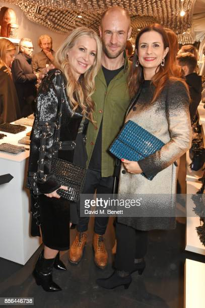 Carmen Busquets Cameron Saul and Livia Firth attend the opening of the BOTTLETOP flagship store on Regent Street on December 5 2017 in London England