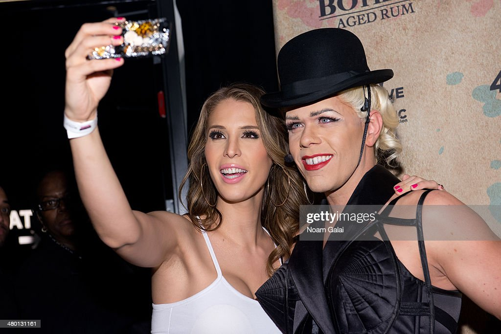 <a gi-track='captionPersonalityLinkClicked' href=/galleries/search?phrase=Carmen+Carrera&family=editorial&specificpeople=7433374 ng-click='$event.stopPropagation()'>Carmen Carrera</a> takes a selfie with <a gi-track='captionPersonalityLinkClicked' href=/galleries/search?phrase=Perez+Hilton&family=editorial&specificpeople=598309 ng-click='$event.stopPropagation()'>Perez Hilton</a> at <a gi-track='captionPersonalityLinkClicked' href=/galleries/search?phrase=Perez+Hilton&family=editorial&specificpeople=598309 ng-click='$event.stopPropagation()'>Perez Hilton</a>'s 36th Birthday 'Madonnathon' at 42West on March 22, 2014 in New York City.