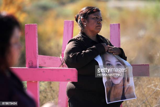 Carmen Castillo holds a picture of her daughter Monica Delgado killed in 2012 during a protest on the eve of the International Day for the...