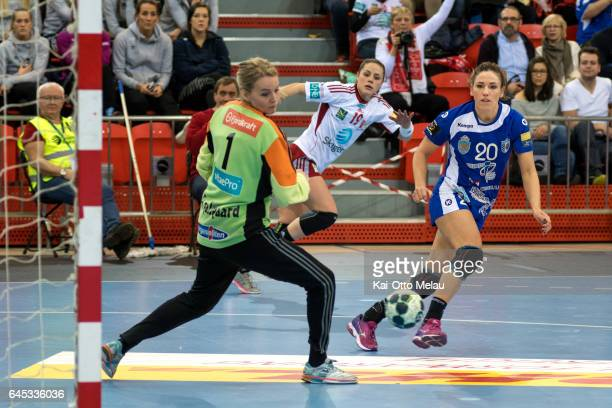 Carmen Dolores Berenguer Martin shoots past Sandra Toft Galsgaard in the Women's EHF Champions league match between Larvik HK and CSM Bucuresti on...