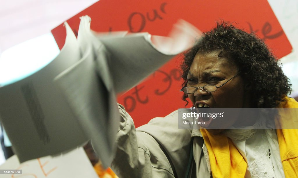 Carmen Edwards waves her mortgage papers during a demonstration outside JPMorgan Chase's annual shareholder meeting in downtown Manhattan May 18 2010...