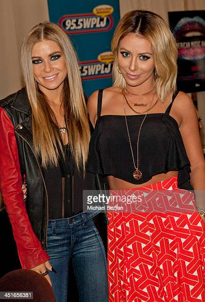 Carmen Electra and Aubrey O'Day attend Flips Audio Headphones Sponsors the Official Artist Gift Lounge Cumulus Radio Row At the American Music Awards...