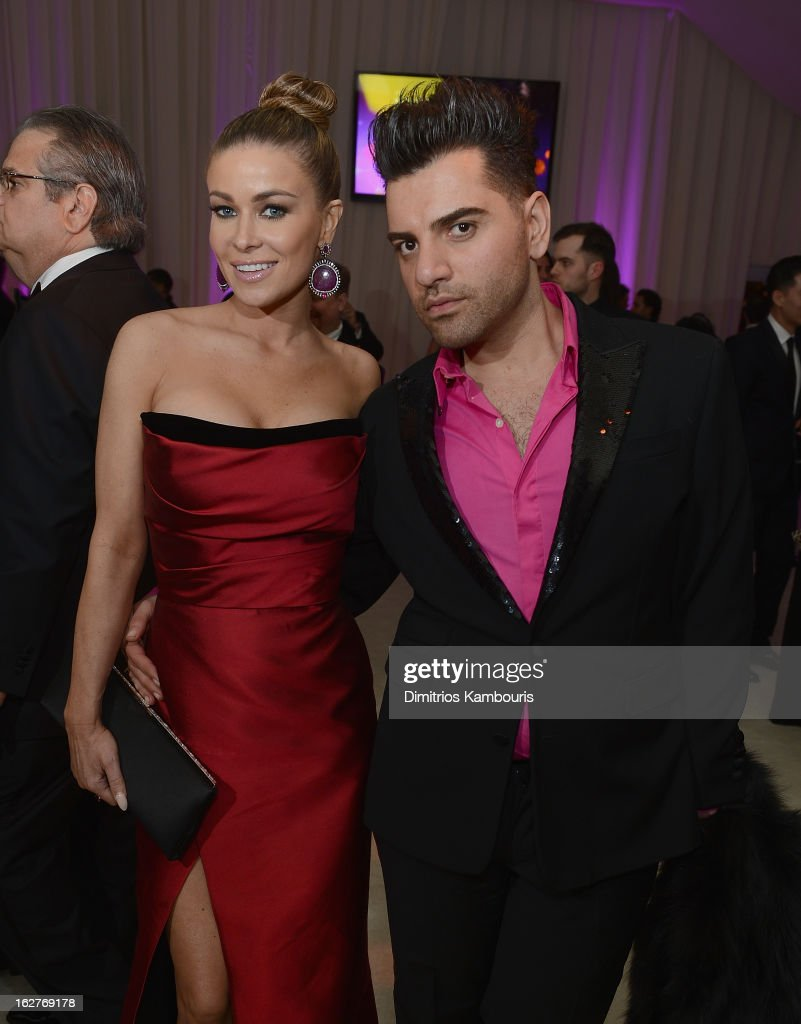 Carmen Electra and guest attend the 21st Annual Elton John AIDS Foundation Academy Awards Viewing Party at West Hollywood Park on February 24, 2013 in West Hollywood, California.