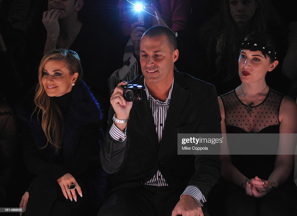 Carmen Electra and Nigel Barker attend the Betsey Johnson Fall 2013 fashion show during Mercedes-Benz Fashion Week at The Studio at Lincoln Center on February 11, 2013 in New York City.