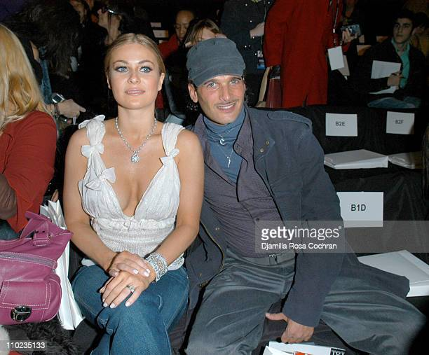 Carmen Electra and Phillip Bloch during Olympus Fashion Week Fall 2005 Y Kei Front Row and Backstage at The Tent in New York City New York United...
