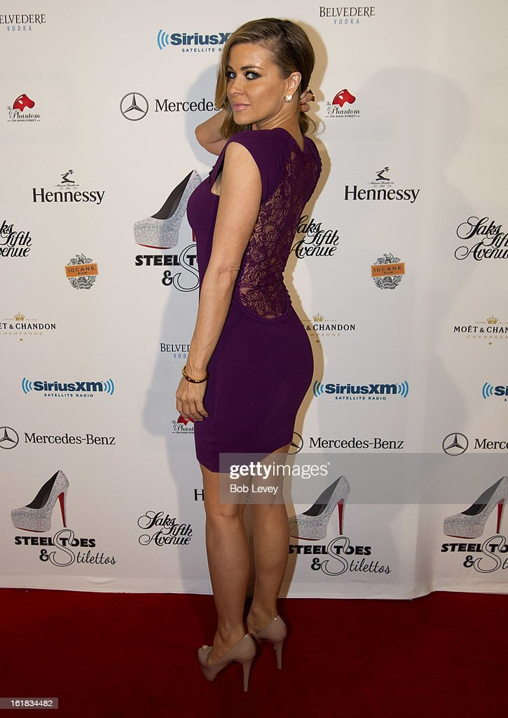 <a gi-track='captionPersonalityLinkClicked' href=/galleries/search?phrase=Carmen+Electra&family=editorial&specificpeople=171242 ng-click='$event.stopPropagation()'>Carmen Electra</a> arrives on the red carpet at Beverly Hills Sports And Entertainment Group Present The Event: Steel Toes And Stilettos Party at The Phantom on February 16, 2013 in Houston, Texas.