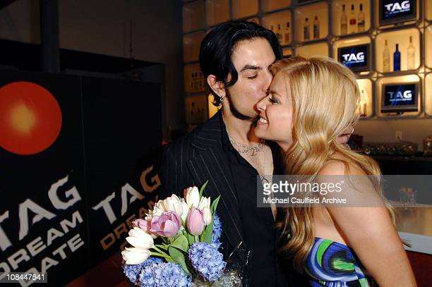 Carmen Electra cozies up to the TAG Body Spray Dream Date winner her rocker husband Dave Navarro The men's fragrance company auctioned off a date...