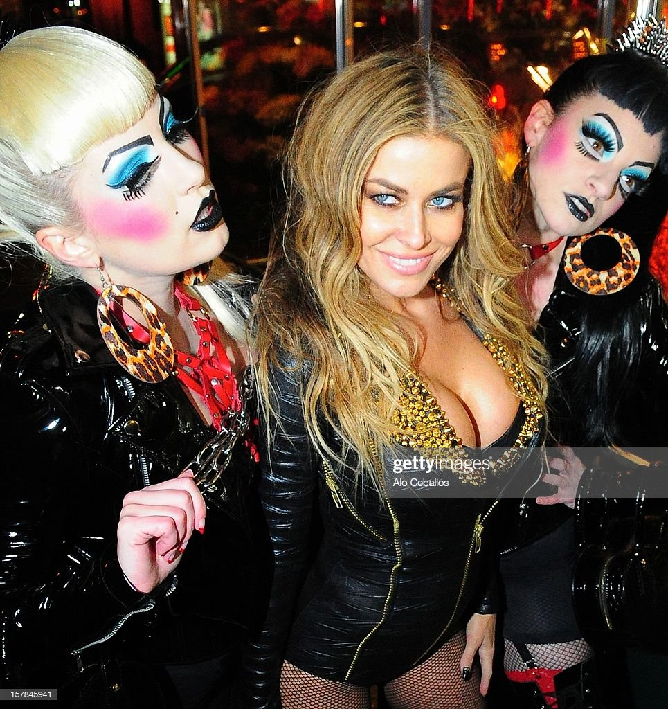 <a gi-track='captionPersonalityLinkClicked' href=/galleries/search?phrase=Carmen+Electra&family=editorial&specificpeople=171242 ng-click='$event.stopPropagation()'>Carmen Electra</a> is seen in Times Square at Streets of Manhattan on December 6, 2012 in New York City.