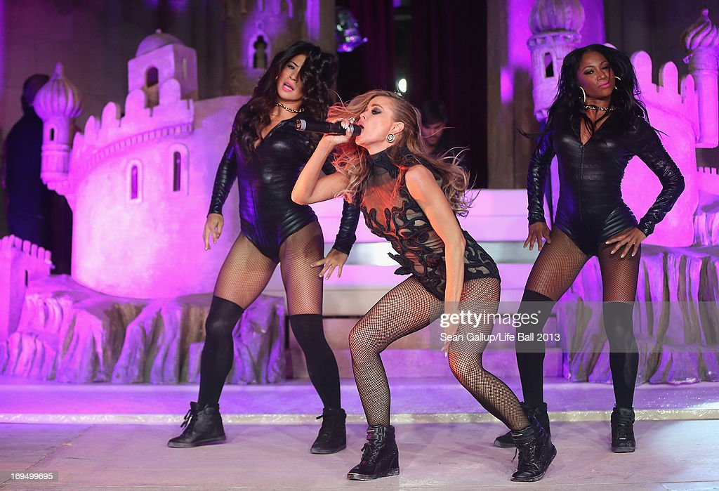 <a gi-track='captionPersonalityLinkClicked' href=/galleries/search?phrase=Carmen+Electra&family=editorial&specificpeople=171242 ng-click='$event.stopPropagation()'>Carmen Electra</a> performs at the after show party at the 2013 Life Ball at city hall on May 25, 2013 in Vienna, Austria.