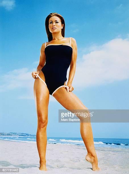 Carmen Electra Wearing a Black Swimsuit