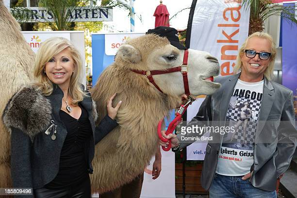 Carmen Geiss and Robert Geiss attend the 'Reisen mit den Geissens' photocall on October 25 2013 in Munich Germany