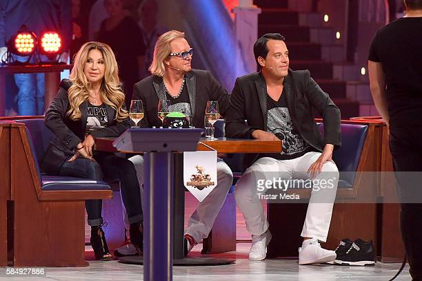 Carmen Geiss her husband Robert Geiss and Gregor Glanz as Team Geissens during the tv show 'Der grosse RTL IIPromiKegelabend' on July 31 2016 in...