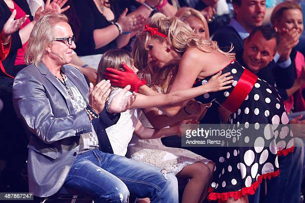 Carmen Geiss kisses her daughters Davina und Shania as Robert Geiss gestures during the 5th show of 'Let's Dance' on RTL at Coloneum on May 2 2014 in...